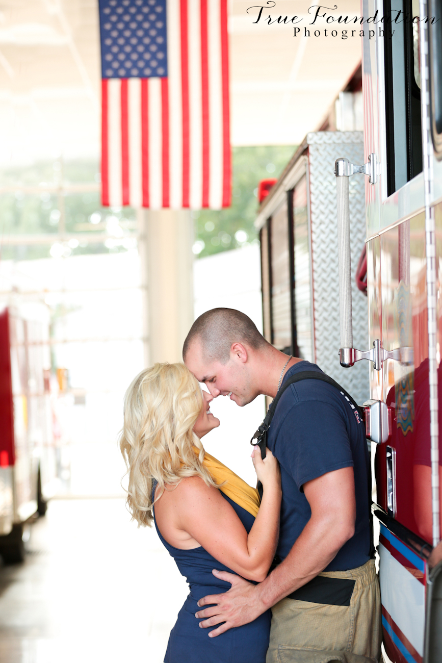 Engagement-Photography-Shelby-North-Carolina-Photographer-Wedding-Inspiration-Fire-Fighter-Man-Station-Red-Yellow-American-flag-couple